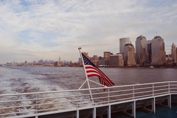 New york skyline from water USA flag
